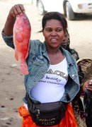 this fish vendor was particulary vocal and insistant that we buy her fish, shot in Mozambique..