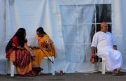 Hare Krishna devotees from the Annual Festival of Chariots take time out.. , in Durban, South Africa,